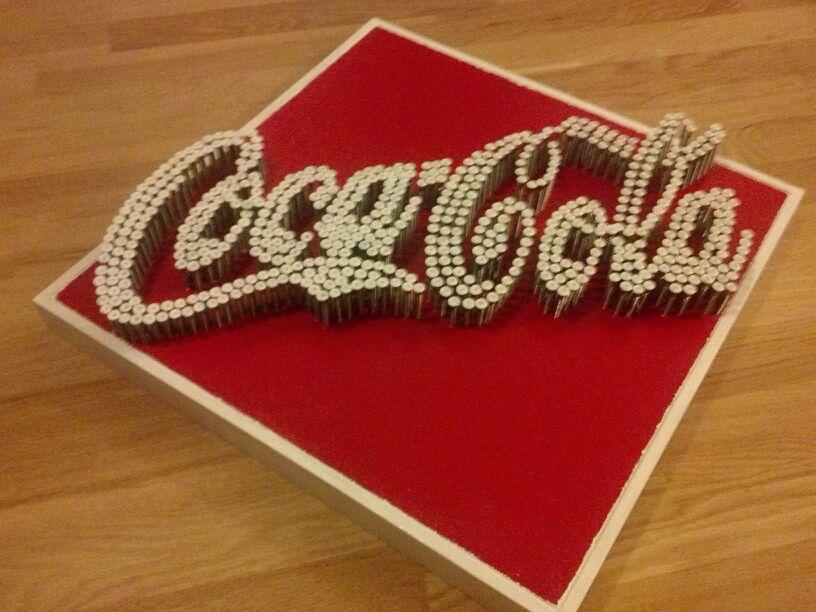 quadro coca cola 3d realizzato con 600 viti