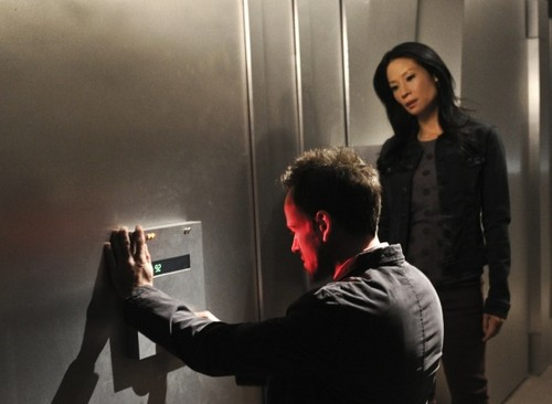 Sherlock & Joan wallpaper probably with an electric refrigerator and a sign entitled Sherlock & Joan