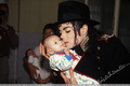 michael and a baby - michael-jackson photo