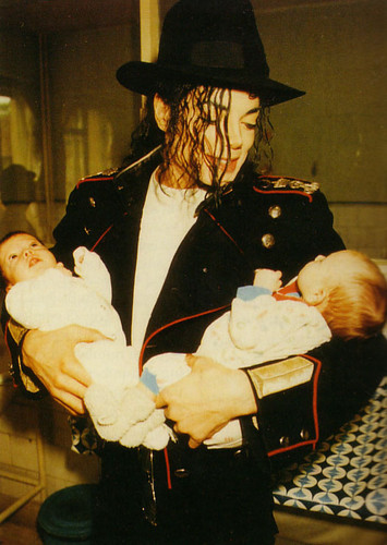 michael holding some babies