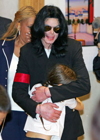 michael hugging some children
