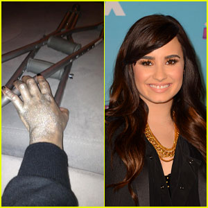 Demi Lovato karatasi la kupamba ukuta possibly containing a portrait entitled Demi Lovato Injures Her Leg - 2013