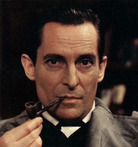 Sherlock Holmes karatasi la kupamba ukuta probably containing a business suit titled Jeremy Brett