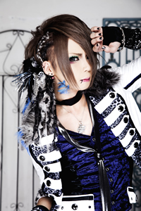 Royz achtergrond possibly containing a hip boot, a playsuit, and an outerwear entitled Kazuki
