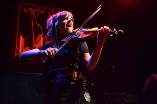 Music wallpaper possibly with a violist and a concert entitled Lindsey Stirling
