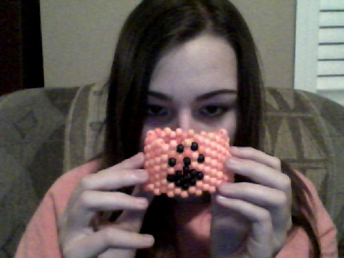 Mcl pawprint bead bracelet and some of my face that i hide >:D