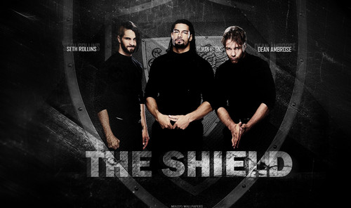 WWE wallpaper containing a sign entitled the shield