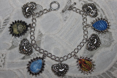 Four (4) Nations Emblems charm bracelet