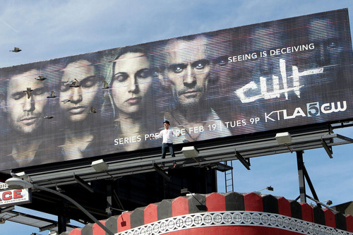 Rob climbed the billboard!!
