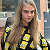 Cara Delevingne фото possibly with a green берет called <33