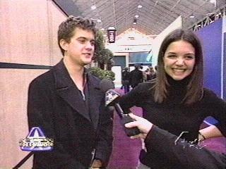 Joshua Jackson & Katie Holmes achtergrond with a business suit titled Josh & Katie