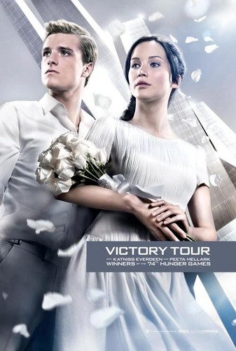 Katniss Everdeen wallpaper containing a bridesmaid entitled Official Catching Fire Poster- Katniss and Peeta