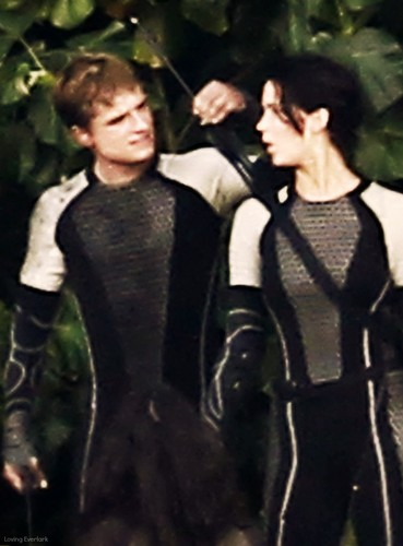 Catching Fire wallpaper possibly containing a business suit and a well dressed person titled Peeta & Katniss-Catching Fire