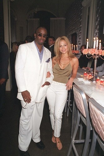 Jennifer Lopez wallpaper possibly containing a business suit called Puff Daddy & Jennifer Lopez 2000