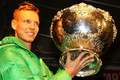 Berdych and DC trophy - tomas-berdych photo