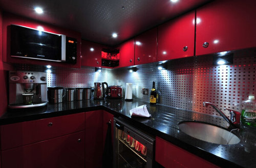 "One Direction پیپر وال with a kitchenette, a kitchen, and a stove titled Inside the One Direction ""Take Me Home"" tour bus."