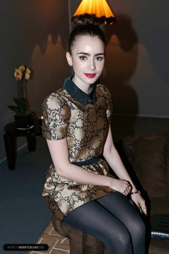 Lily attends the Louis Vuitton Fall/Winter Показать during Paris Fashion Week [06/03/13]
