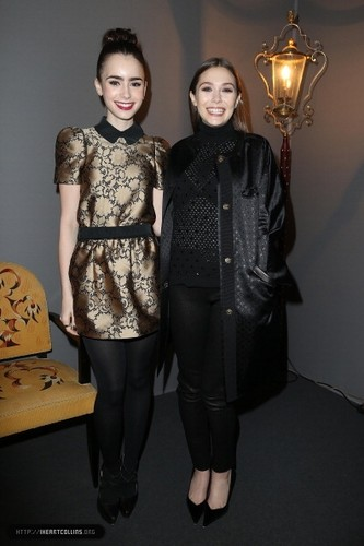 Lily attends the Louis Vuitton Fall/Winter toon during Paris Fashion Week [06/03/13]