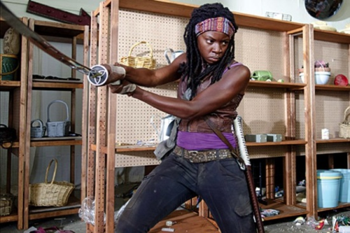 Michonne achtergrond probably containing a street, a hip boot, and a pantleg titled Michonne