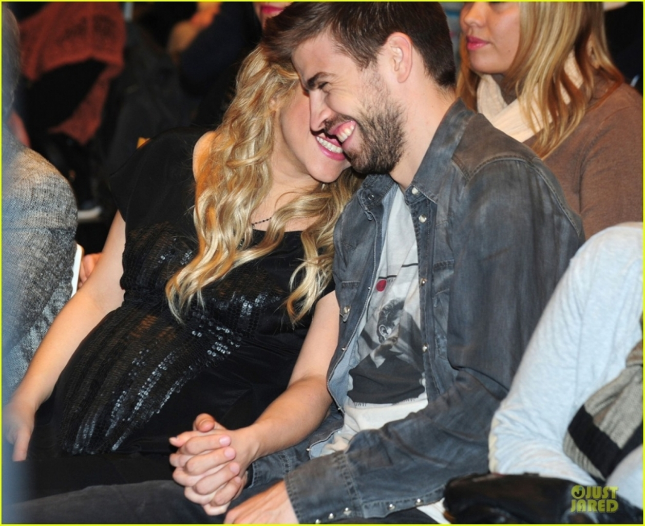Shakira pregnant belly translucent shirt..
