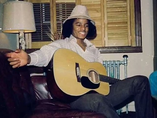 Sweet young Michael playing guitar!