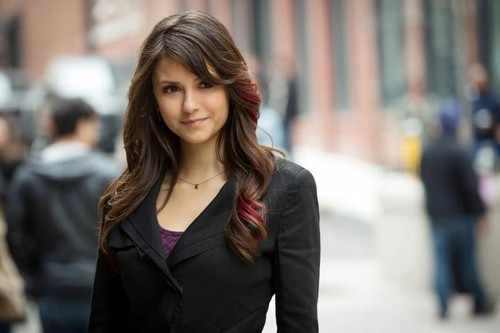 The Vampire Diaries TV toon achtergrond with a business suit, a well dressed person, and a portrait called Elena's new haircut