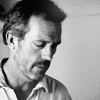 Dr. Gregory House photo possibly with a portrait called House