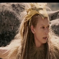 Jadis looks at Aslan on the cliff top.
