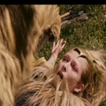 Jadis on the ground and tries to reach her sword.