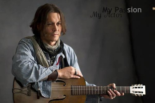 johnny depp fondo de pantalla probably with a guitarist called Johnny :)