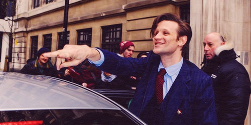 Matt Smith 壁纸 probably with a street, a business suit, and a 赤褐色砂石, 褐砂石, 上流社会 called Matt