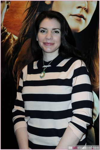 Stephenie Meyer Hintergrund probably with an outerwear, a parasol, and a leisure wear called SM