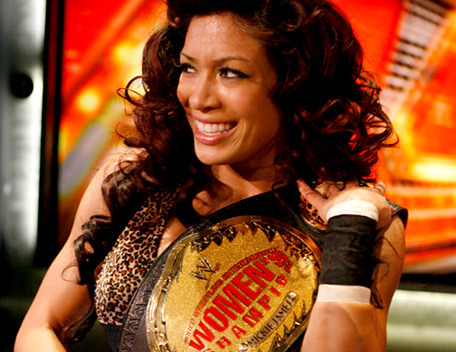 Melina Perez kertas dinding with a bongo, a snare drum, and a bass drum called melina first win as womans champ.