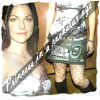 Amy Lee photo probably with a surcoat and a portrait entitled AL<3