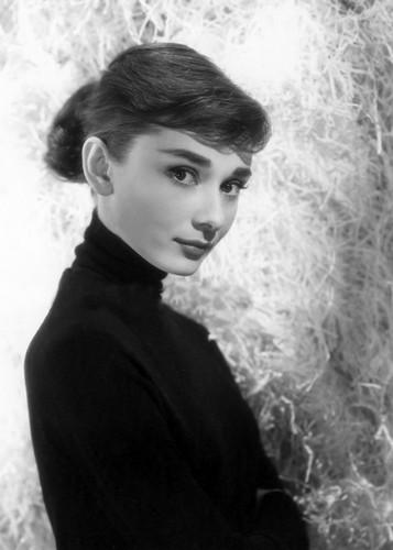 Audrey Hepburn wallpaper possibly with a sign titled Audrey Hepburn