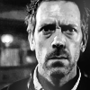 Dr. Gregory House photo probably containing a judge advocate, a business suit, and a portrait titled House