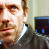 Dr. Gregory House photo probably containing a business suit, a judge advocate, and a portrait called House