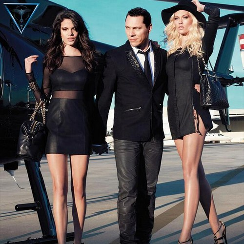 Antm winners Hintergrund possibly with a business suit, a well dressed person, and a hip boot entitled Laura James Guess campaign