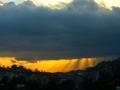 The sun behind the dark cloud - photography photo