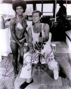A Vintage Autographed Poster Signed By Roger Moore And Gloria Hendry