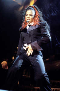 The 90s wallpaper with a business suit, a concert, and a well dressed person called Janet Jackson