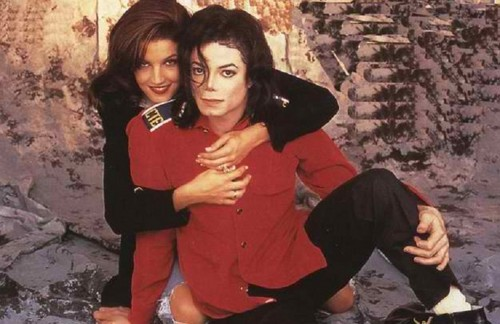 The 90s wallpaper possibly with an outerwear, a playsuit, and a well dressed person entitled Michael Jackson And Lisa Marie Presley 1994 Wedding Photo