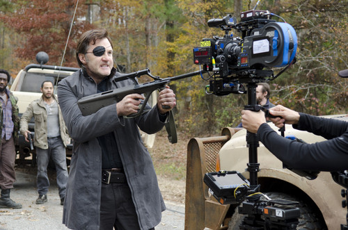 The Walking Dead wallpaper containing a rifleman titled The Walking Dead - 3x16 - Welcome to the Tombs - Behind the Scenes