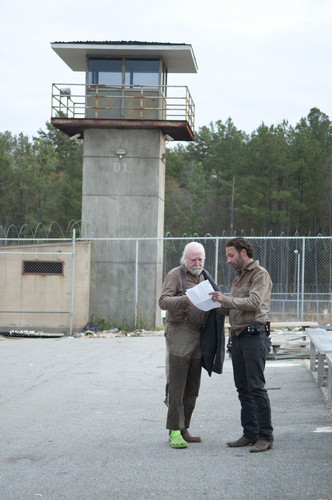 The Walking Dead wallpaper possibly with a street, a sign, and a granary entitled The Walking Dead - 3x16 - Welcome to the Tombs - Behind the Scenes