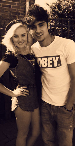 Zayn And Perrie wallpaper probably containing a sign and a street entitled Zayn and perrie