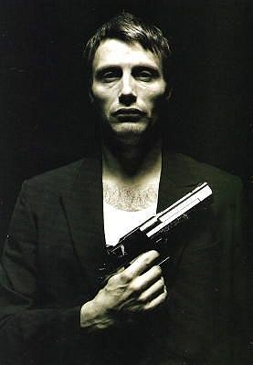 hot man with a gun