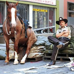 rick and his horse sitting - the-walking-dead Photo