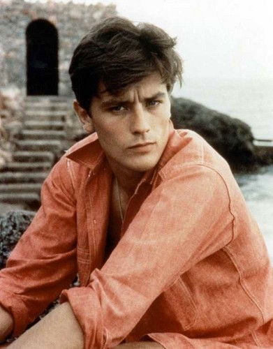 Alain Delon wallpaper probably with an outerwear, a street, and a well dressed person titled Alain Delon