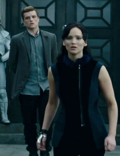 Katniss Everdeen wallpaper with a business suit called Catching Fire Teaser Trailer