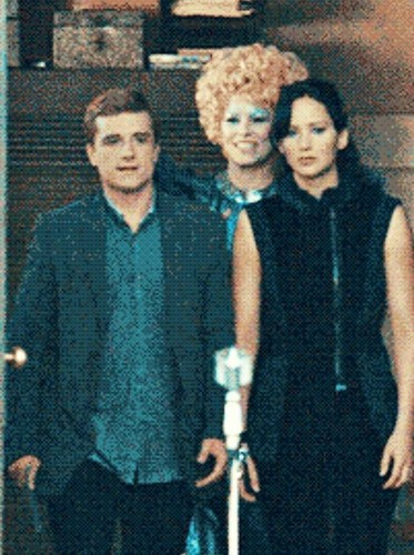Catching Fire wallpaper possibly with a well dressed person entitled Peeta & Katniss-Catching Fire